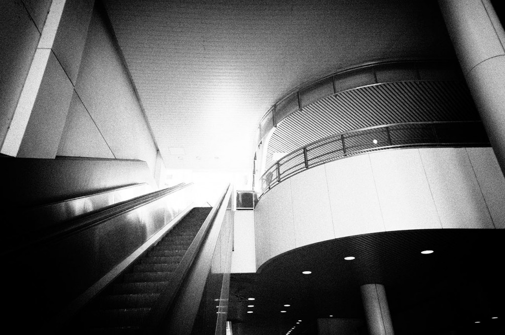 Into The Light is a photo of an escalator leading up from a parking garage in Harrisburg, PA
