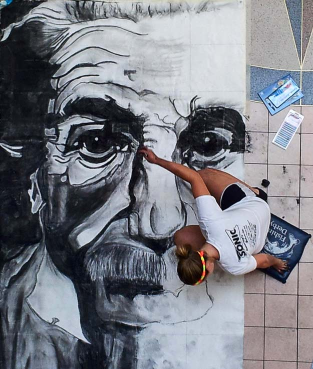 A talented young artist works on her charcoal rendition of Albert Einstein at Chalk It Up!