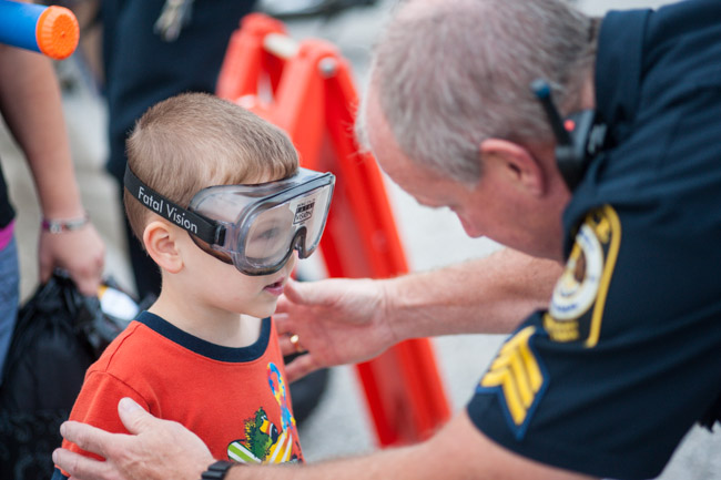 Putting on Fatal Vision Goggles at York Area Regional's National Night Out