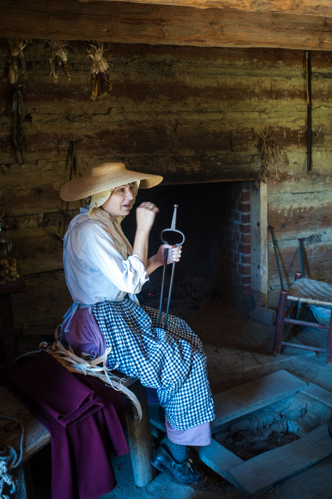 A woman farmer in her home on the farm at Colonial Williamsburg