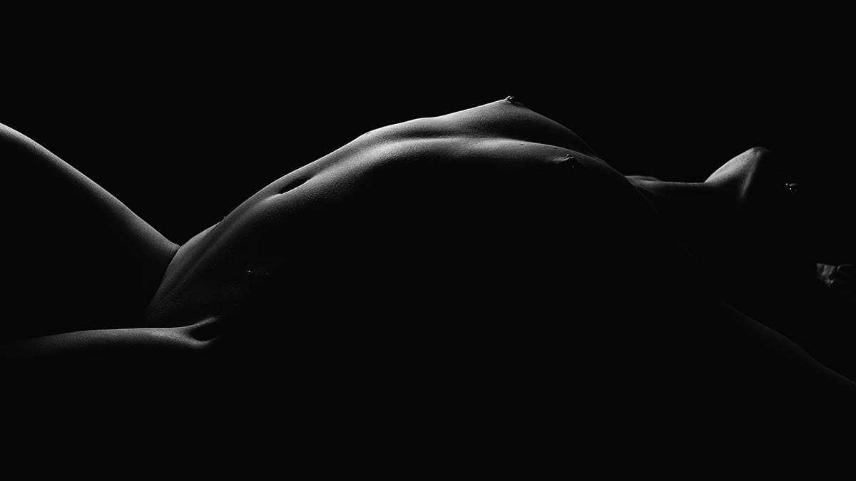 One light black and white, nude bodyscapes photography of Carly