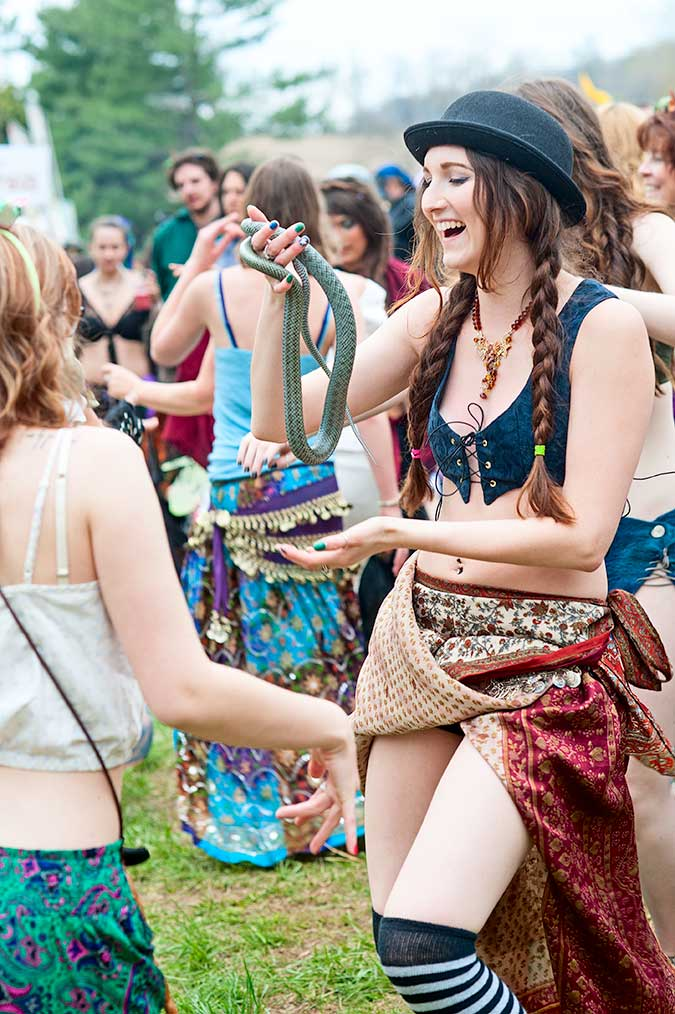 Dancing with a snake at the drum circle at the 23rd Annual May Day Fairie Festival at Spoutwood Farm, Glen Rock, PA in 2014