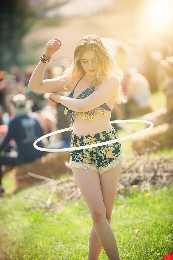 Photo of Rowyn Sage dancing with a hola hoop at the 24th Annual May Day Fairie Festival 2015