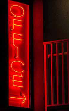The office is open. Neon Office sign glowing in the night. Ocean City Maryland.