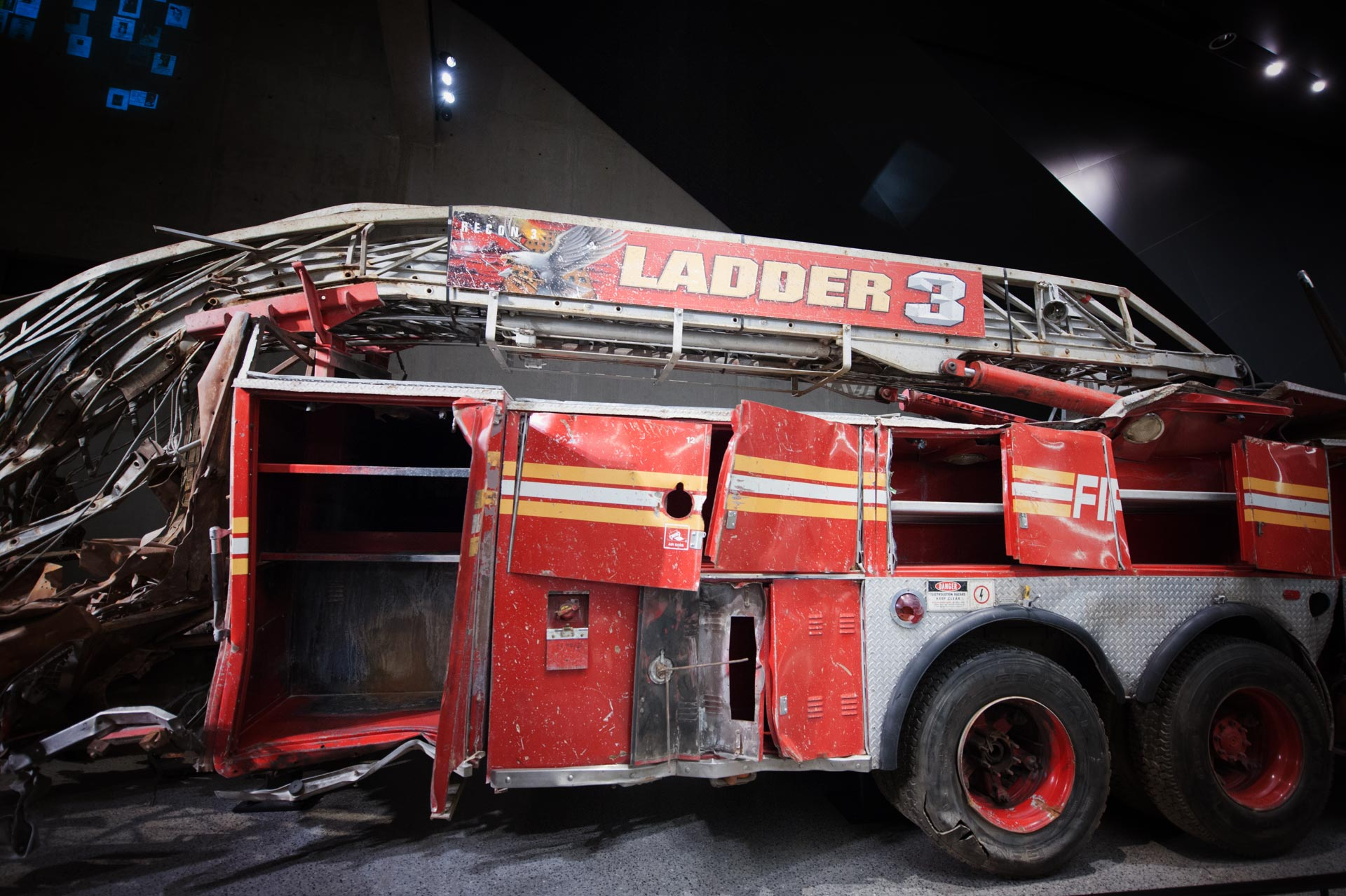 "The remains of ""Ladder 3."" at the National September 11 Memorial Museum. On the morning of the attacks, it carried eleven firefighters to the scene. All of eleven them died in the collapse of the towers."