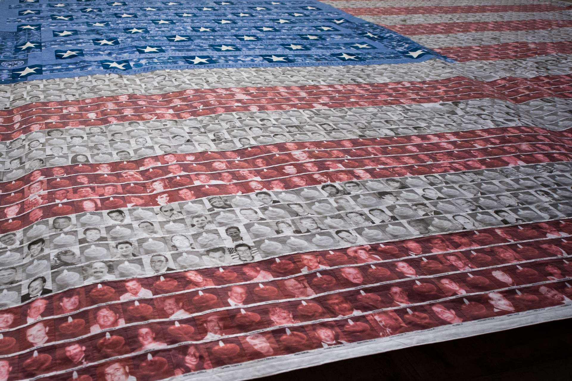 Flag made from photos of the victims of the 9/11 terror atacks at National September 11 Memorial Museum in New York, NY, USA