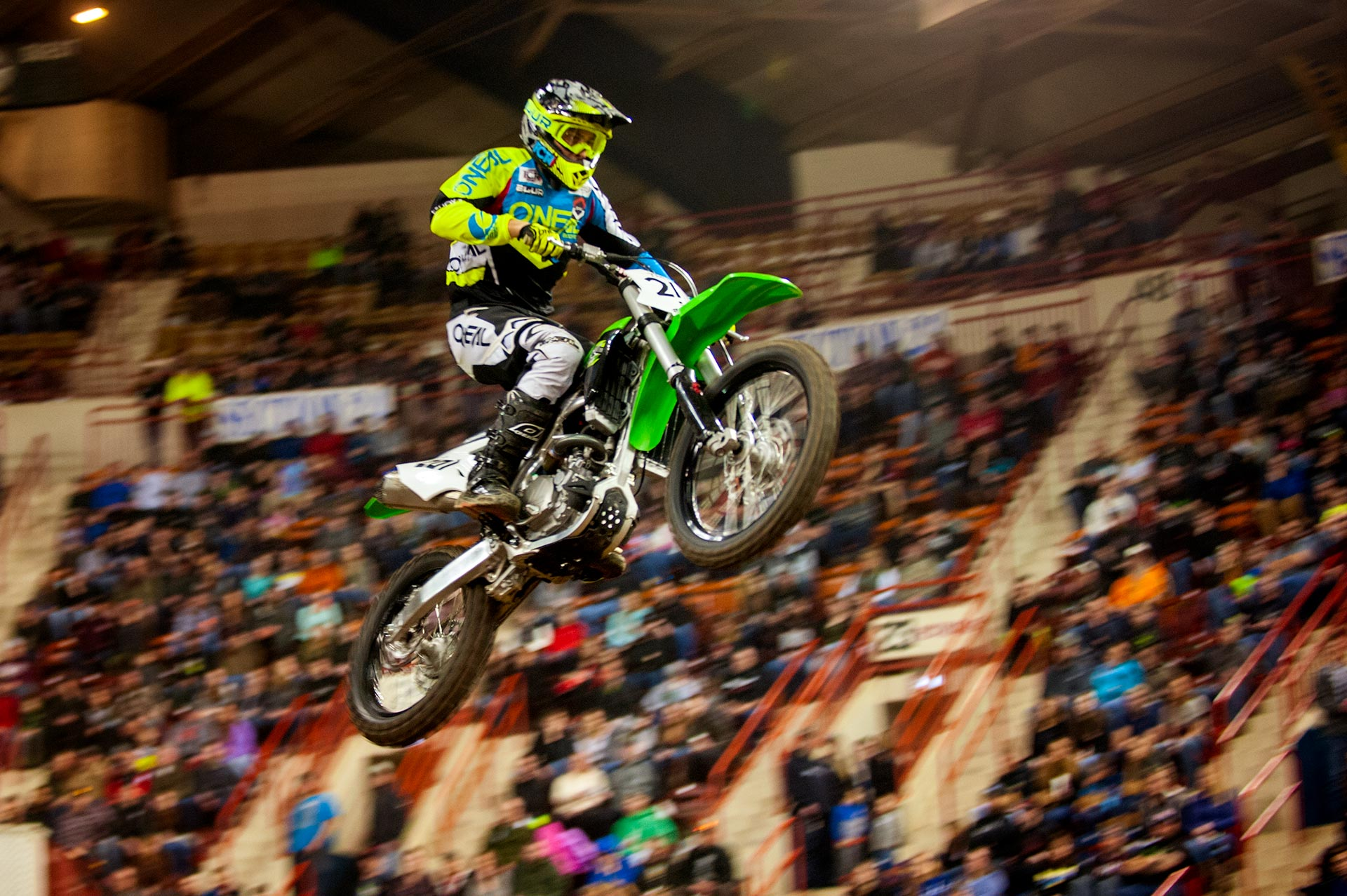 A bike flying through the air at the arenacross races at Motorama 2018