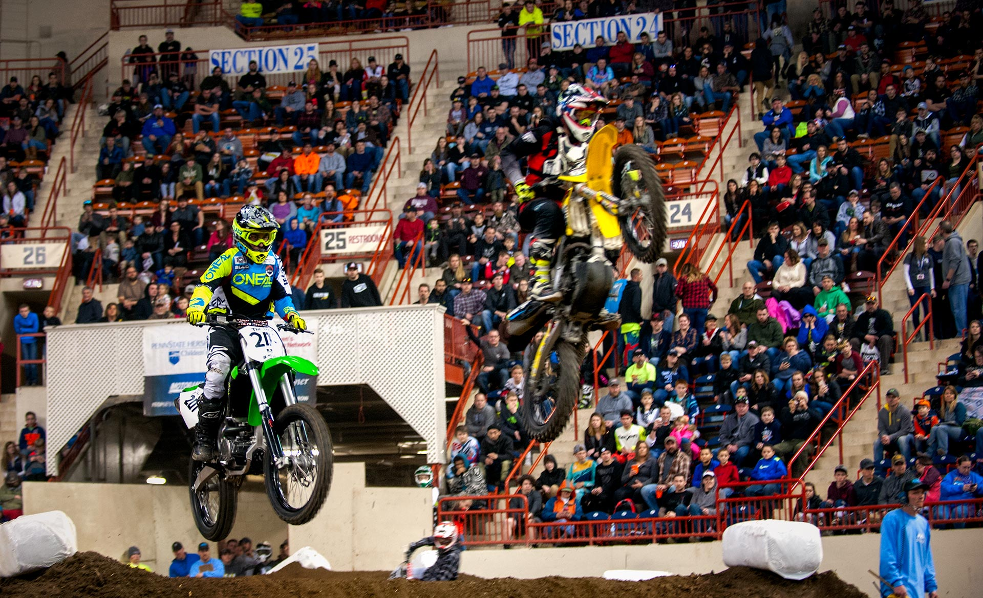 Bikes flying through the air at the arenacross races.