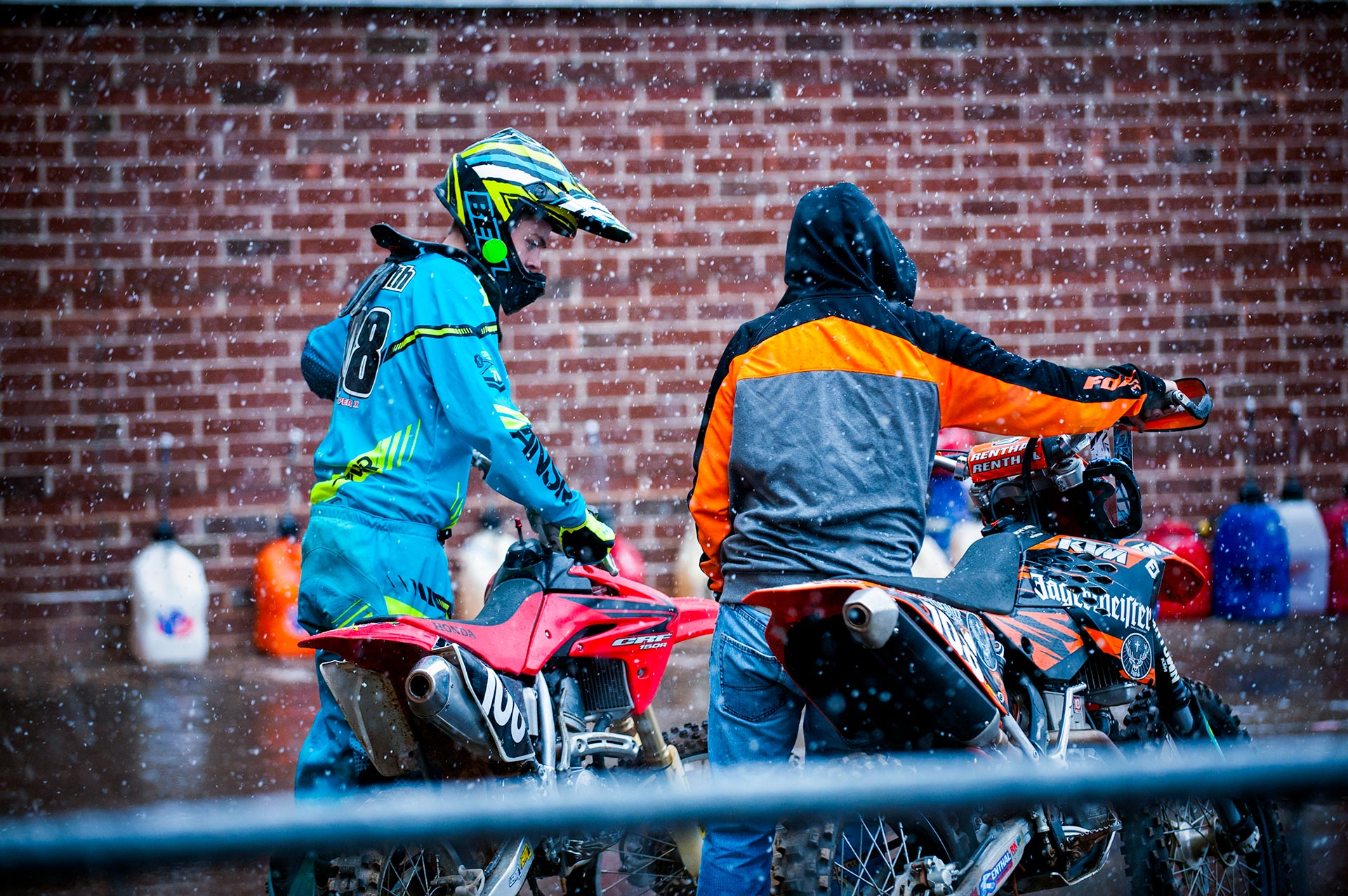 Racers fulling and reding thier bikes for the races in the snow.