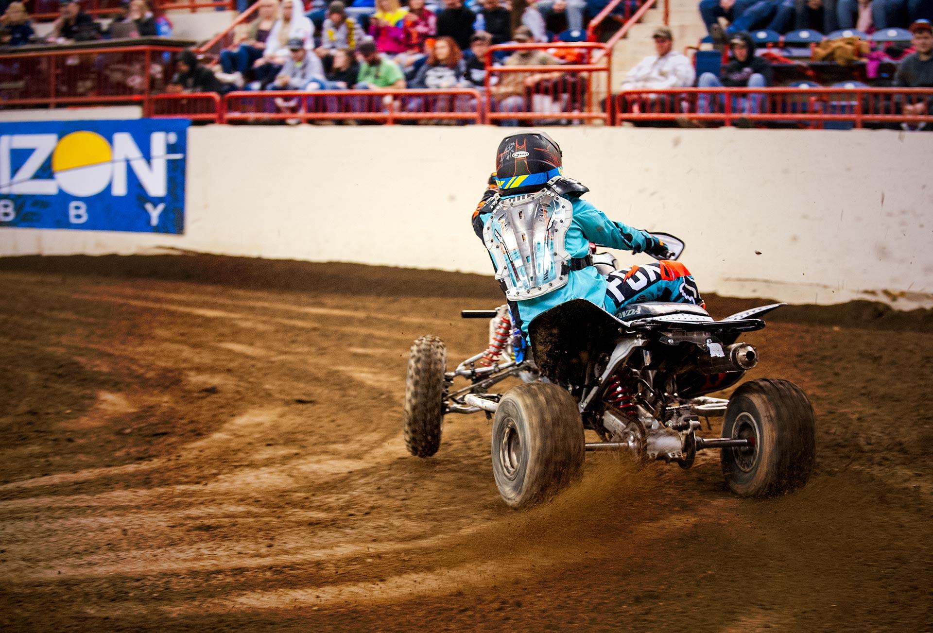A quad slides into the turn at Motorama 2018. Main Arena Pennsylvania Farm Show Complex, Harrisburg, PA