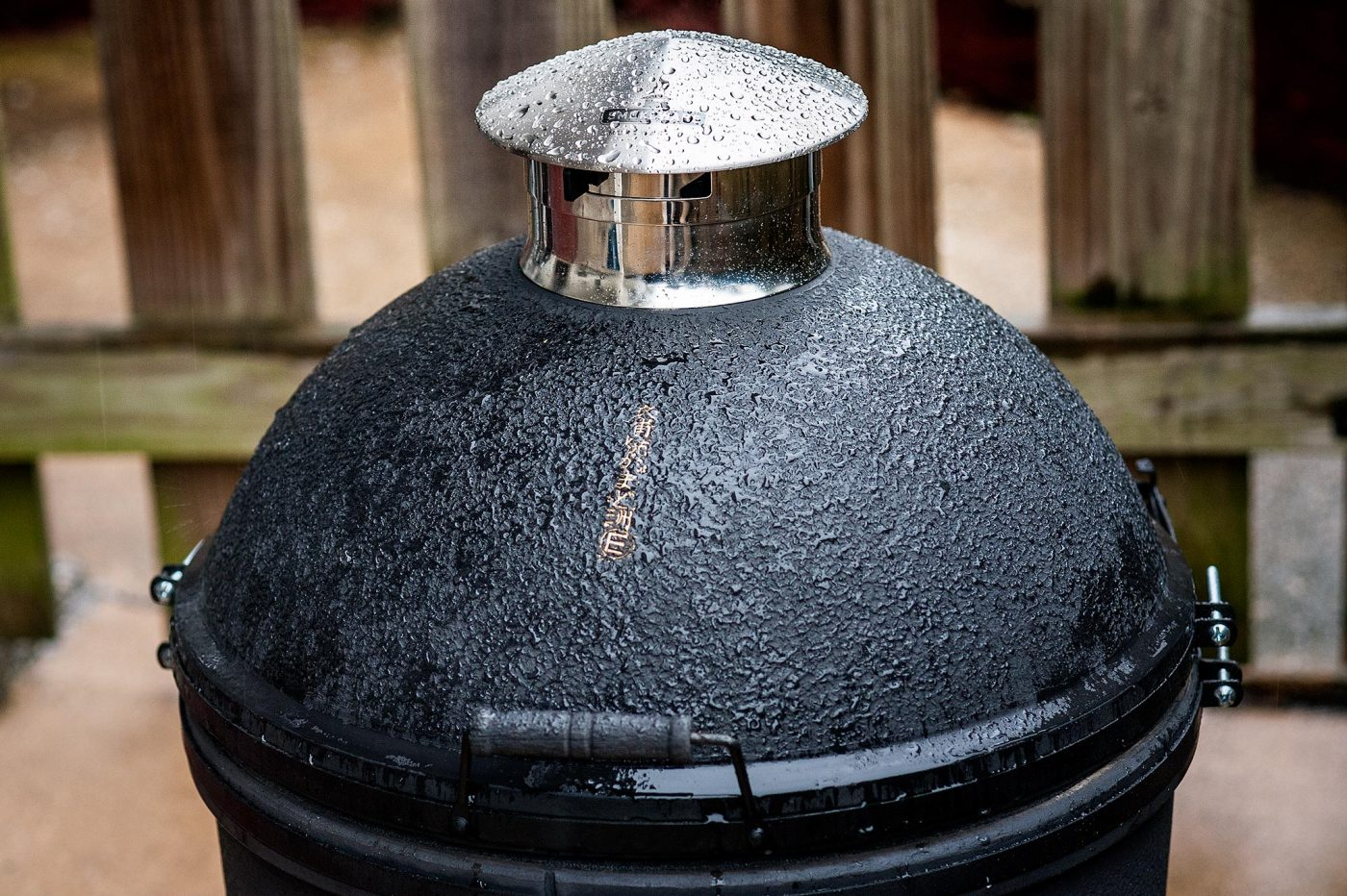 The Restoration of an Antique Kamado by Kinuura Yaki Pottery of Japan. With Smokeware Chimney Cap in the rain